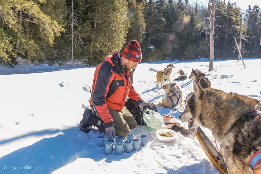 Winterdance guide prepares snacks and hot chocolate during Ontario dog sled tour
