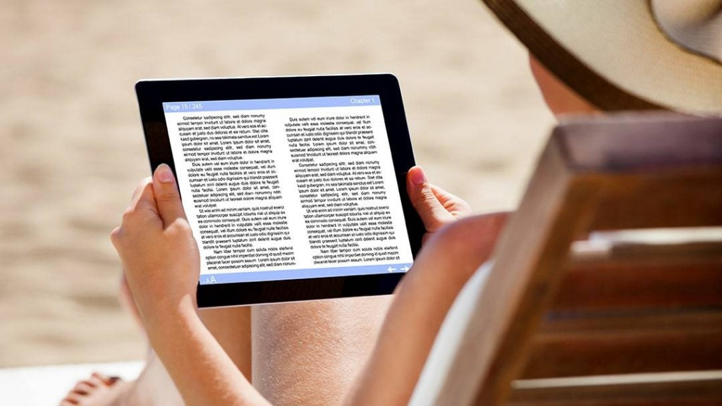 woman on chair reading on beach best e-readers for the beach and the outdoors