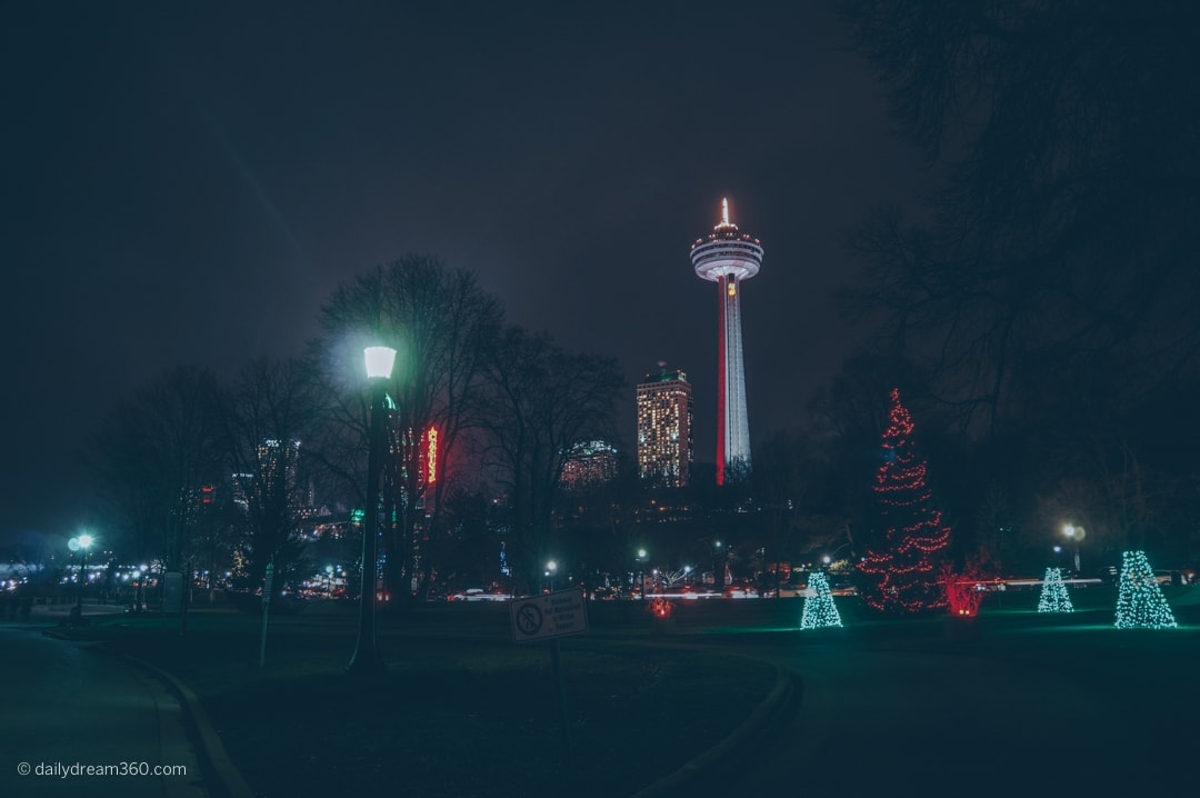 Skylon tower and festival of lights displays in Niagara Falls at night.