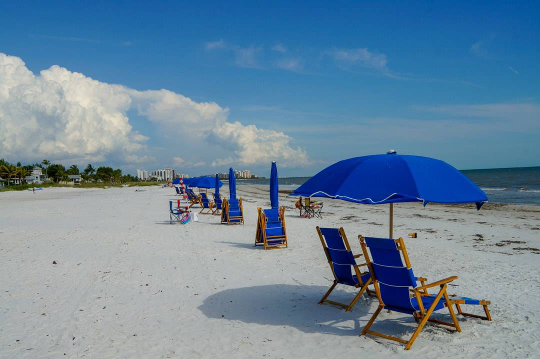Lounge chairs on the beach in front of Sandpiper Gulf Resort Hotel Fort Myers Beach Florida