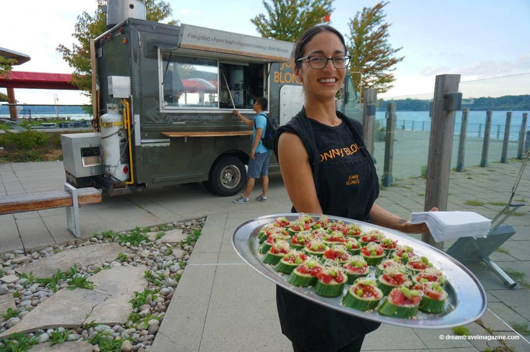 Server holding tray outside Jonny Blonde Food Truck Hamilton Ontario