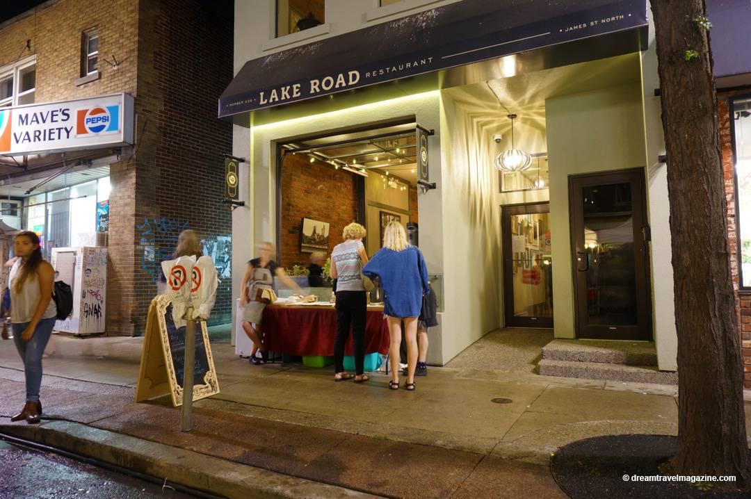 Lake Road Restaurant store front at night in hamilton ontario.