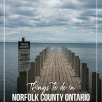 View down wooden pier on Lake Erie with text Things to do in Norfolk County Ontario