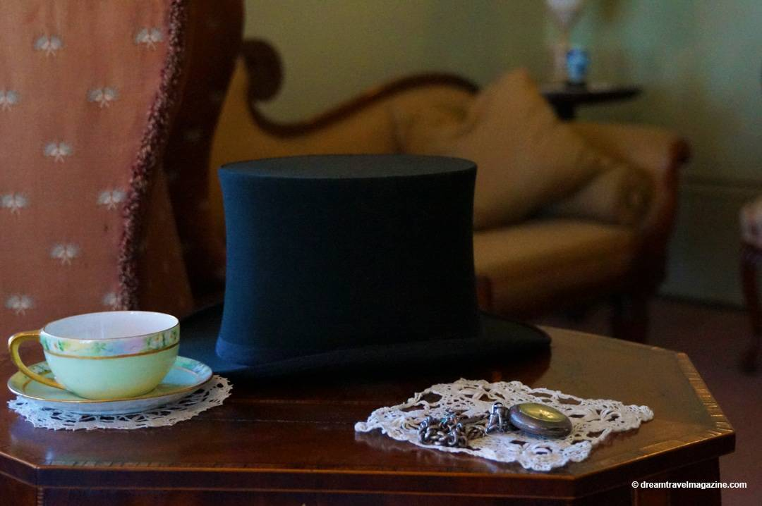 Display of top hat on table with tea cup at Eldon House London Ontario
