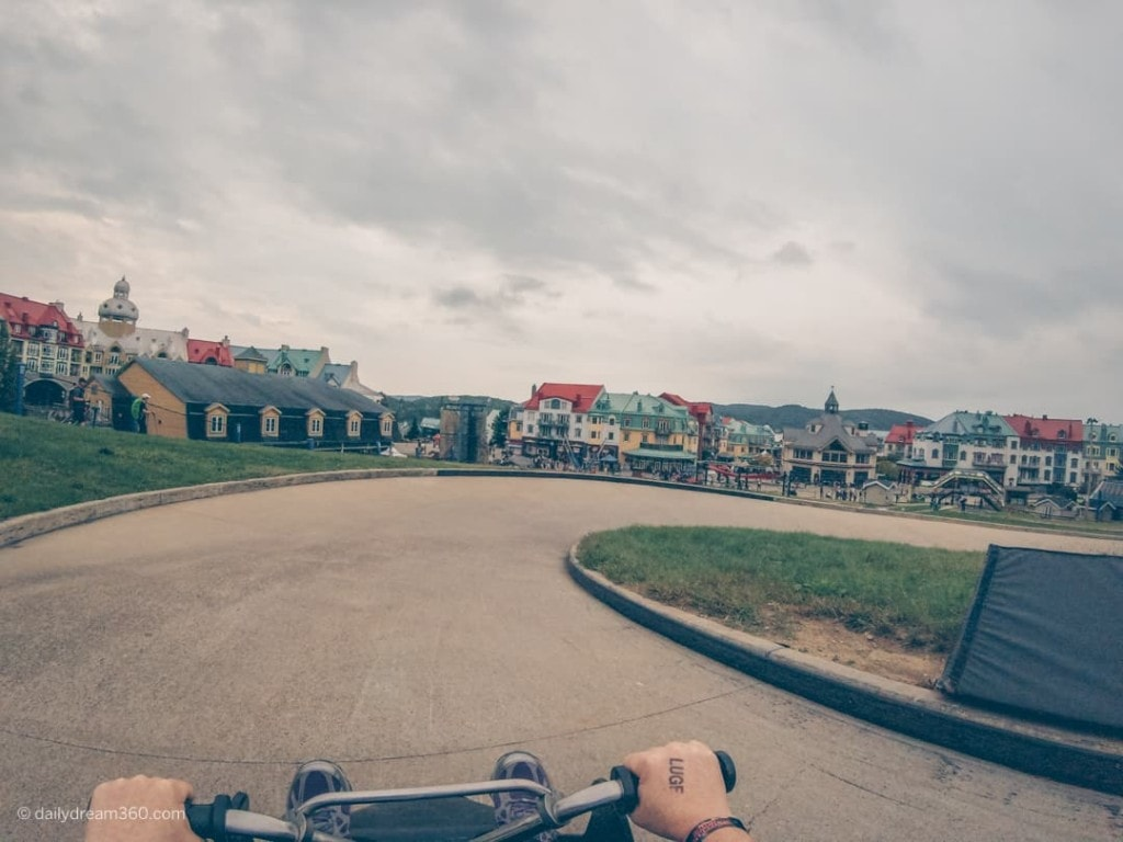 Riding into the village on luge at Tremblant