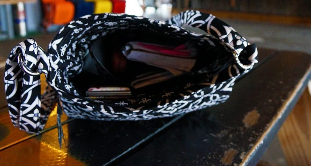 inside the bag, on a table Vera Bradley travel gear the double zip mailbag concerto pattern