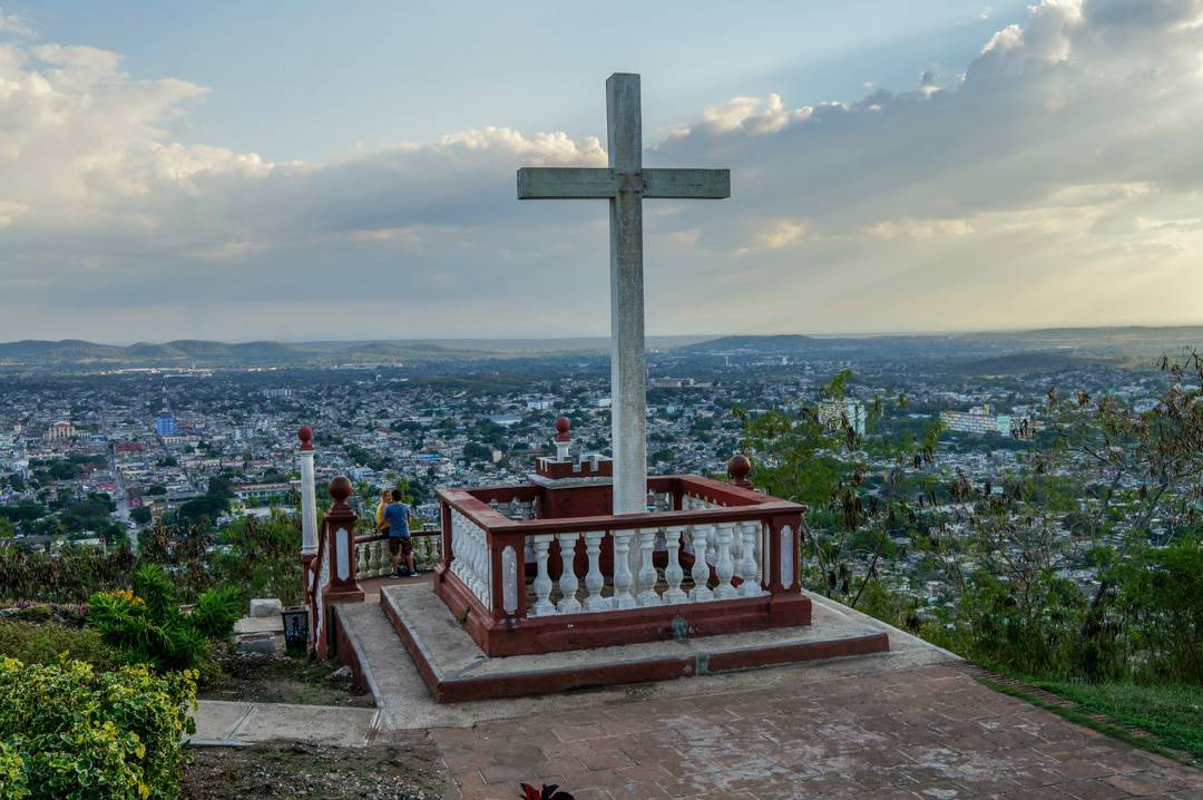 Cross at top of mountain City of Holguin Cuba