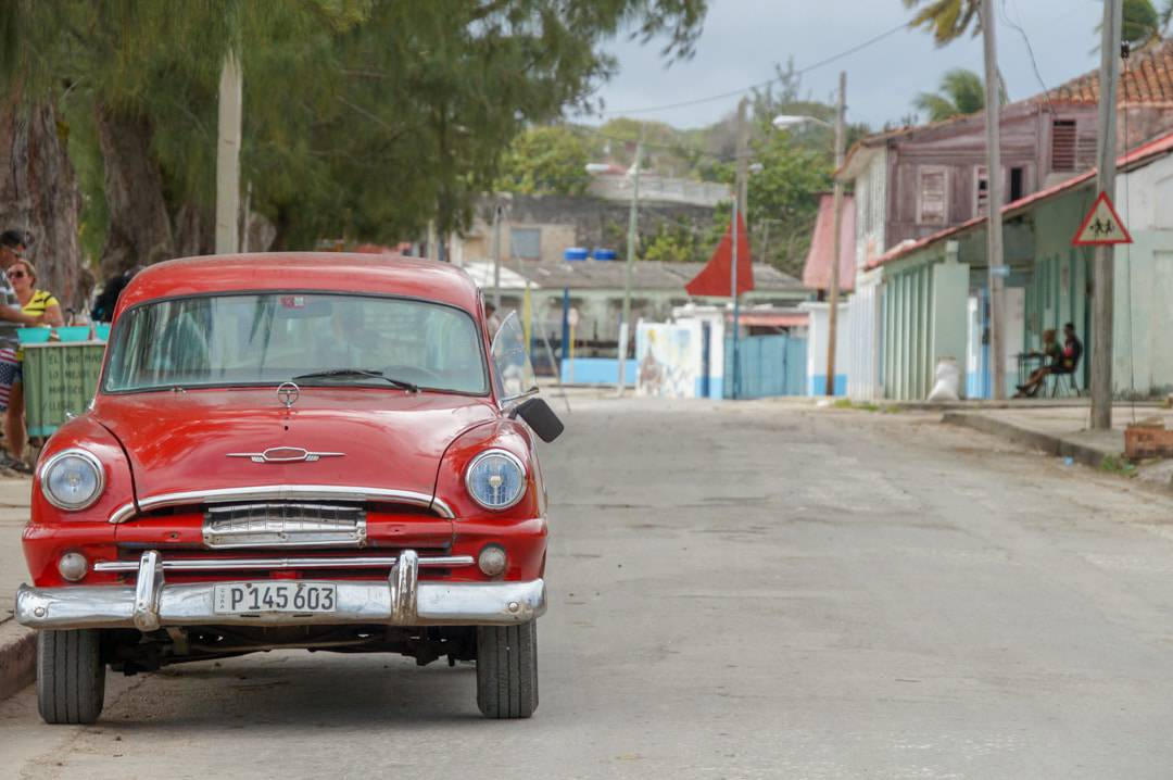 old car on street Gibara Cuba Fishing Village-147