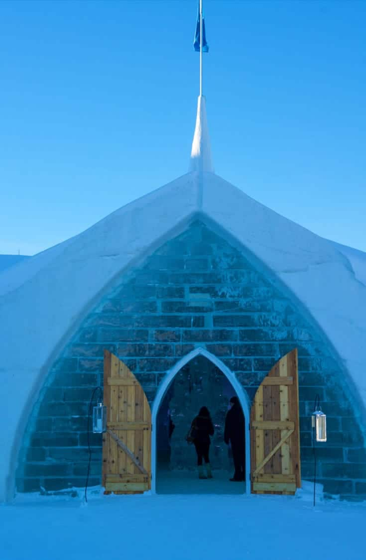 Quebec City's Hotel de Glace welcomes visitors for day tours and overnight stays in the Ice Hotel. Explore the ice carved walls and rooms which are updated each year with a new theme. | ice hotel | Quebec City | Winter | attraction | Quebec | ice bar |