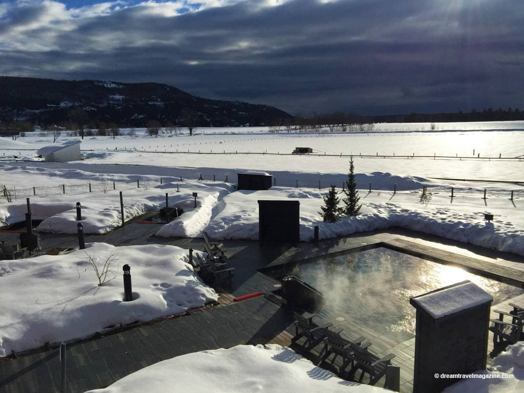 Outdoor thermal spa pools at sunrise at Le Germain Hotel Charlevoix Quebec