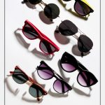 Multiple sunglasses spread out with text Buying The Right Sunglasses: The 10 Best Classic Sunglasses Styles