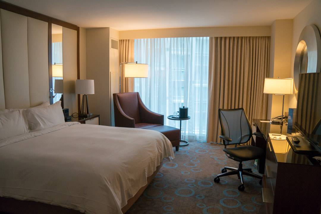bed and lounge chair Marriott Marquis Washington DC Conference Hotel
