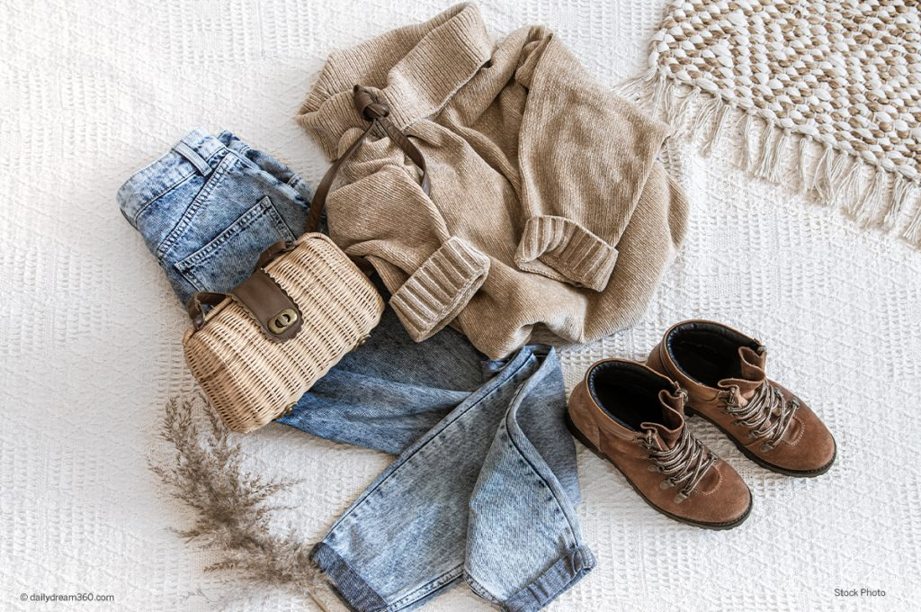 winter clothing on bed