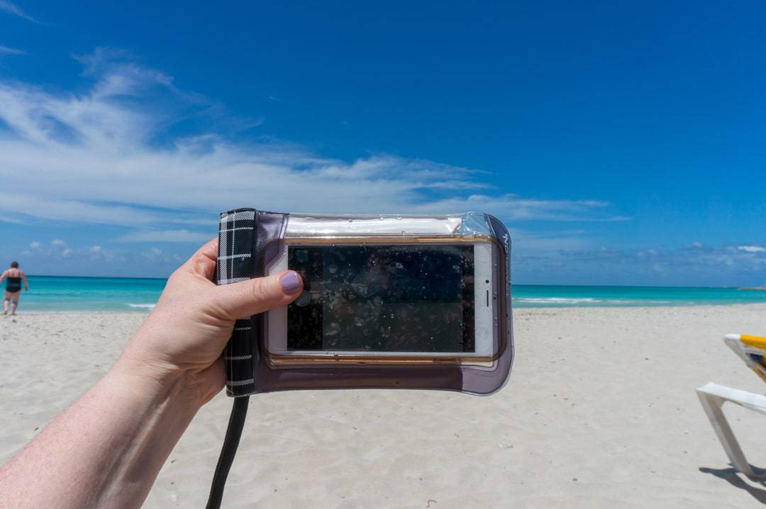Travelon waterproof smartphone pouch still allows you to use the phone
