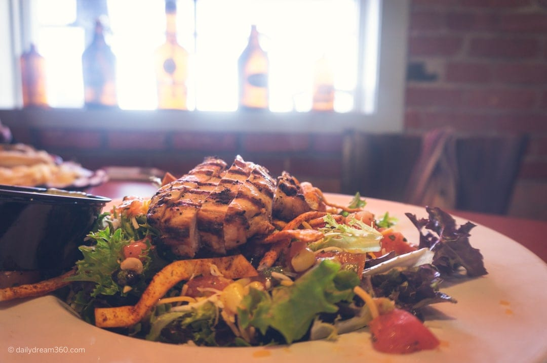 Grilled chicken salad at Inside the ground floor shop at Black Button Distilling Rochester New York