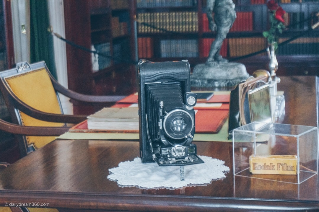 Old camera sits on a desk in exhibit at George Eastman Museum in Rochester