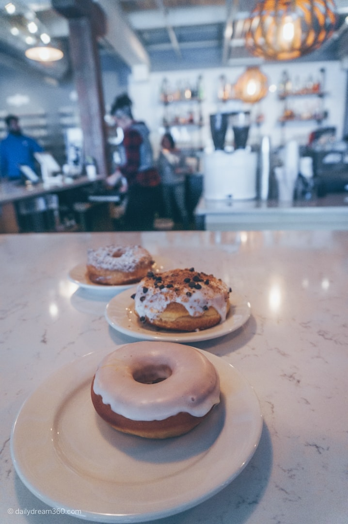 Three doughnuts on counter at BXCR Donuts in Rochester NY