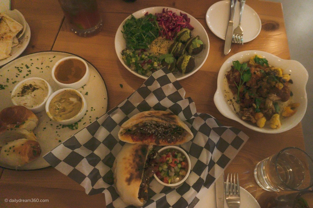 Table filled with Middle Eastern food at Radio Social Restaurant Rochester for Adults