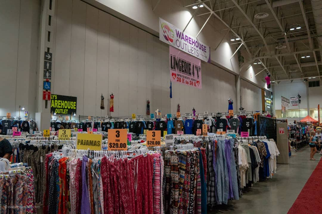 warehouse sales section at CNE clothes hanging on racks