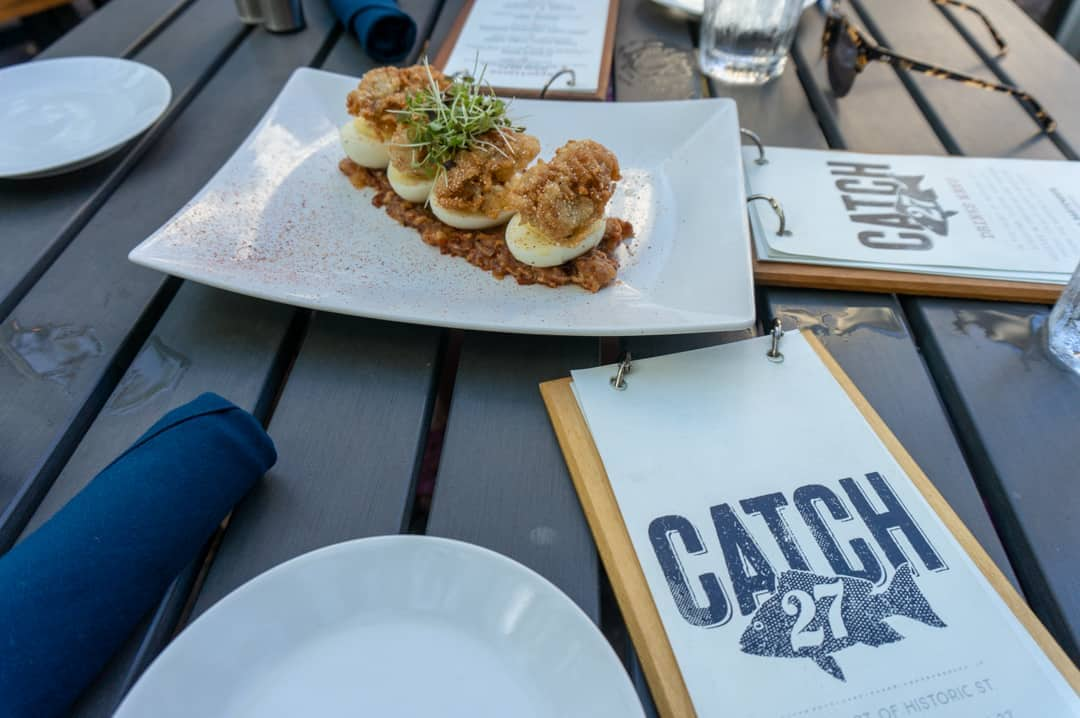 Appetizer on table with menu and plates at Catch 27 Restaurant St Augustine