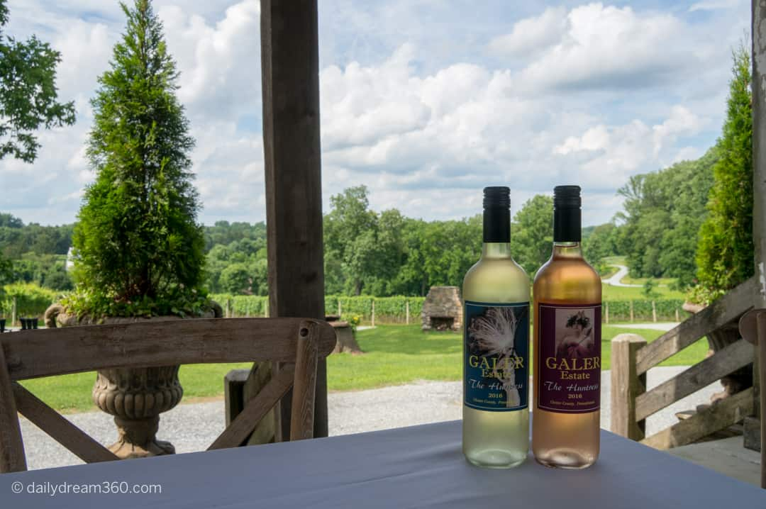 Two bottles on table overlooking winery at Galar Estate Vineyard