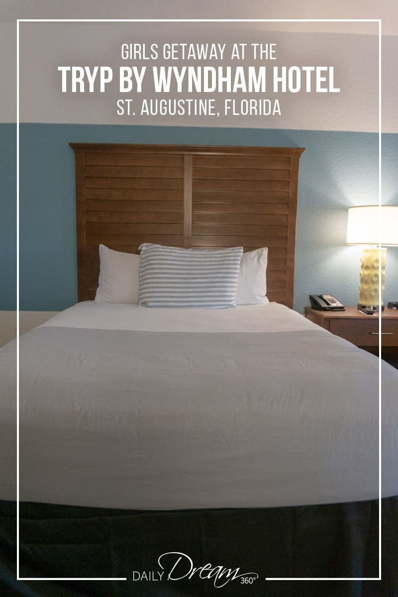 Bed in room of Tryp by Wyndham St. Augustine with words Girls Getaway at the Tryp by Wyndham Hotel
