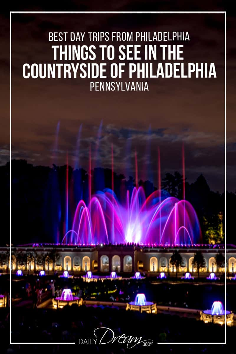 Close up of water fountains lit up in purple and pink at Longwood Gardens