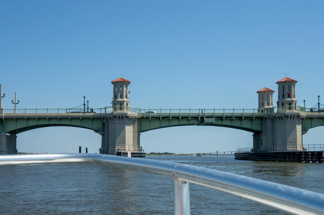 Boat driving towards bridge on Matanzas river in St. Augustine Florida