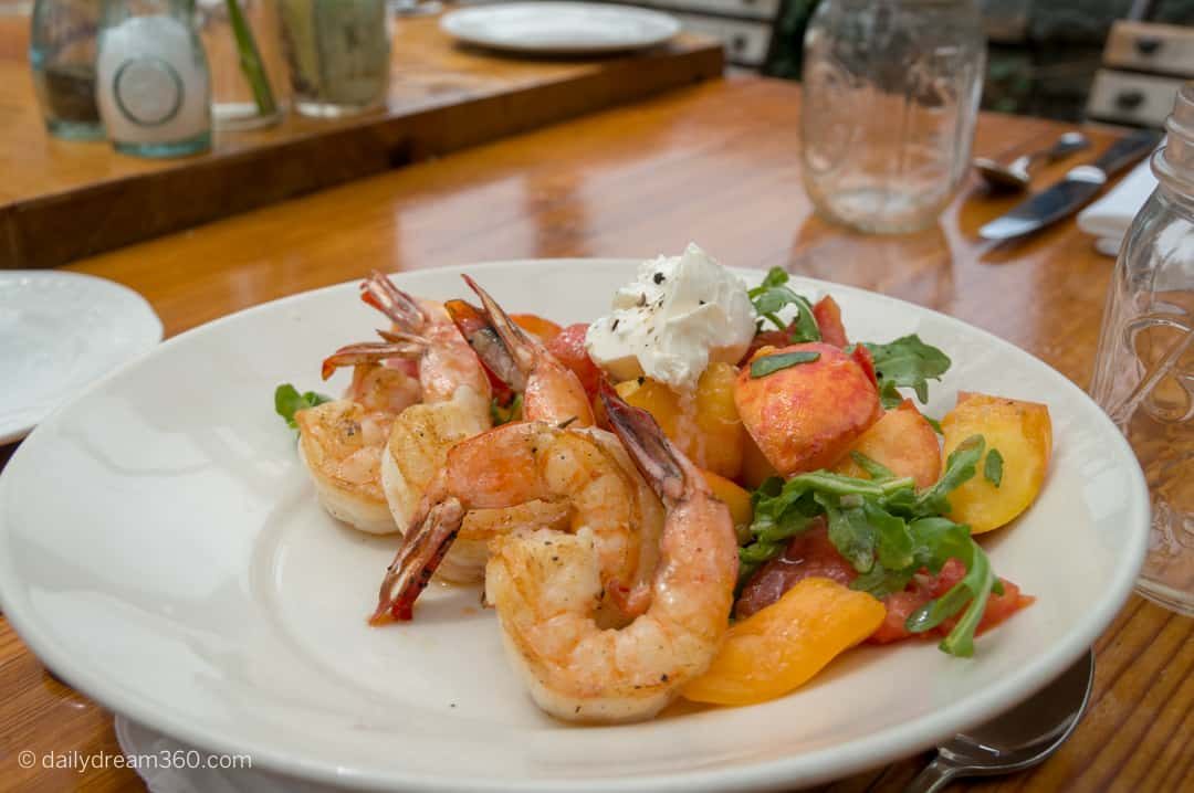 Peach salad with grilled shrimp on plate at Styer's Garden Cafe PA