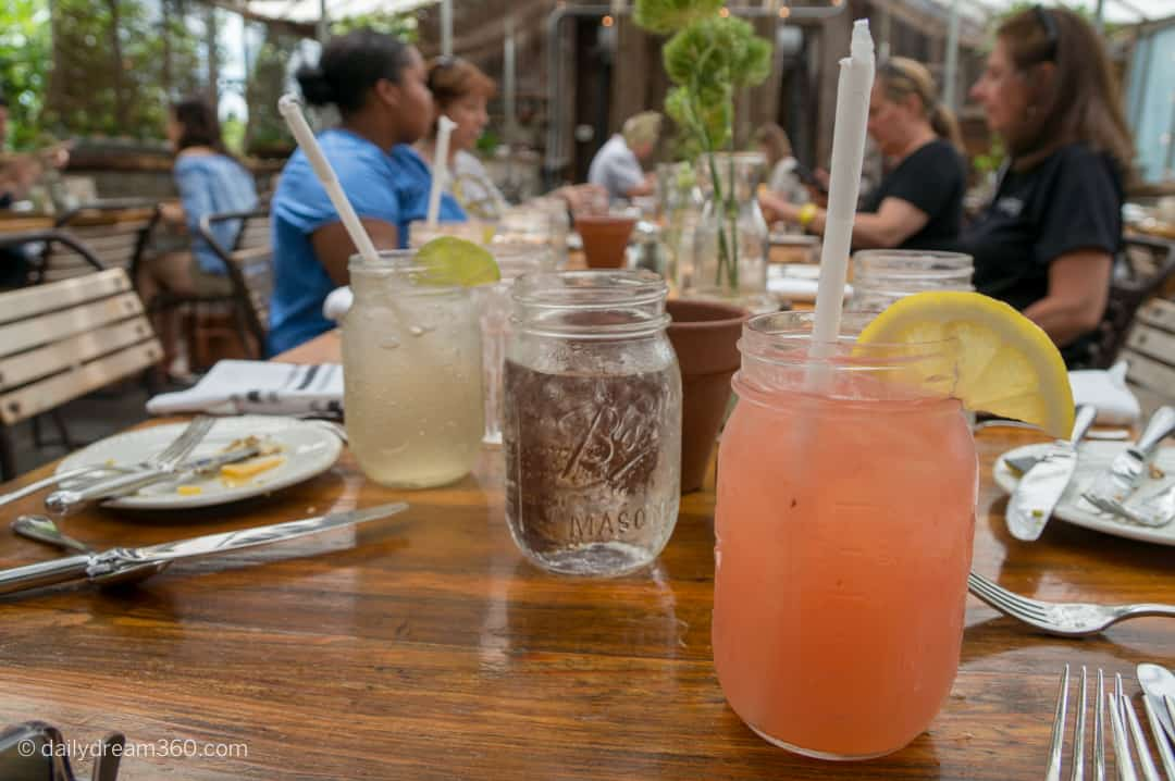 fresh squeezed pink lemonade in mason jar on table
