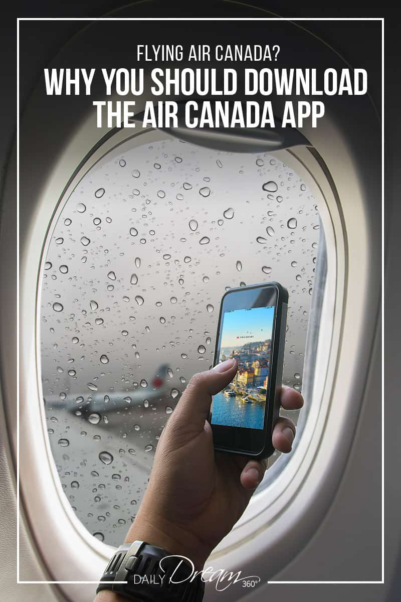 hand holding phone in airplane window covered with raindrops with blurred air canada plane in background of window