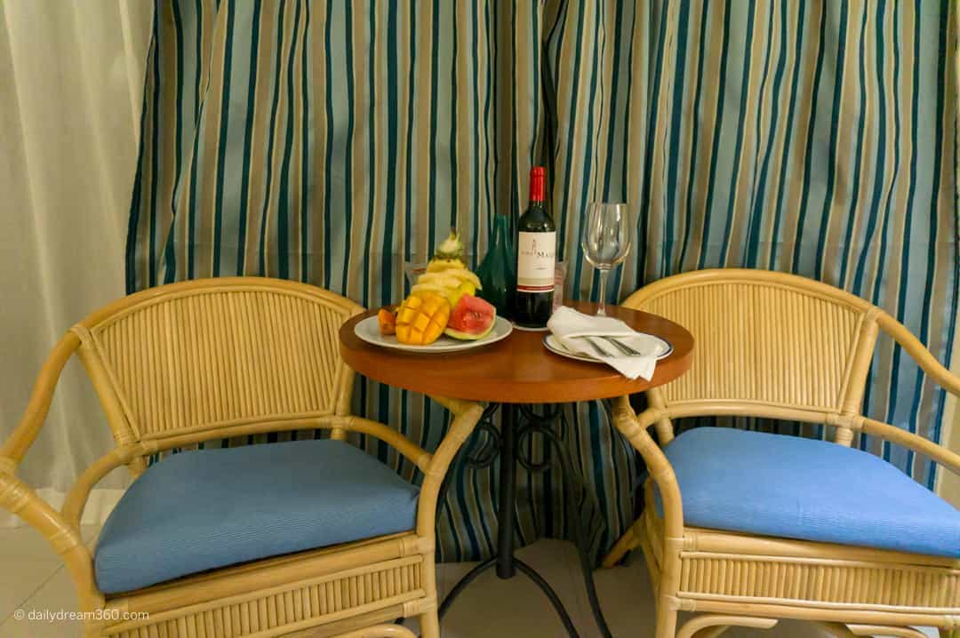 Table and chairs with wine and food at Hotel Playa Costa Verde Holguin Cuba