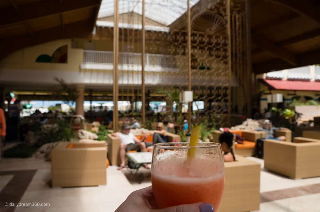 person holding drink with lobby in background Iberostar Daiquiri, Cayo Guillermo, Cuba