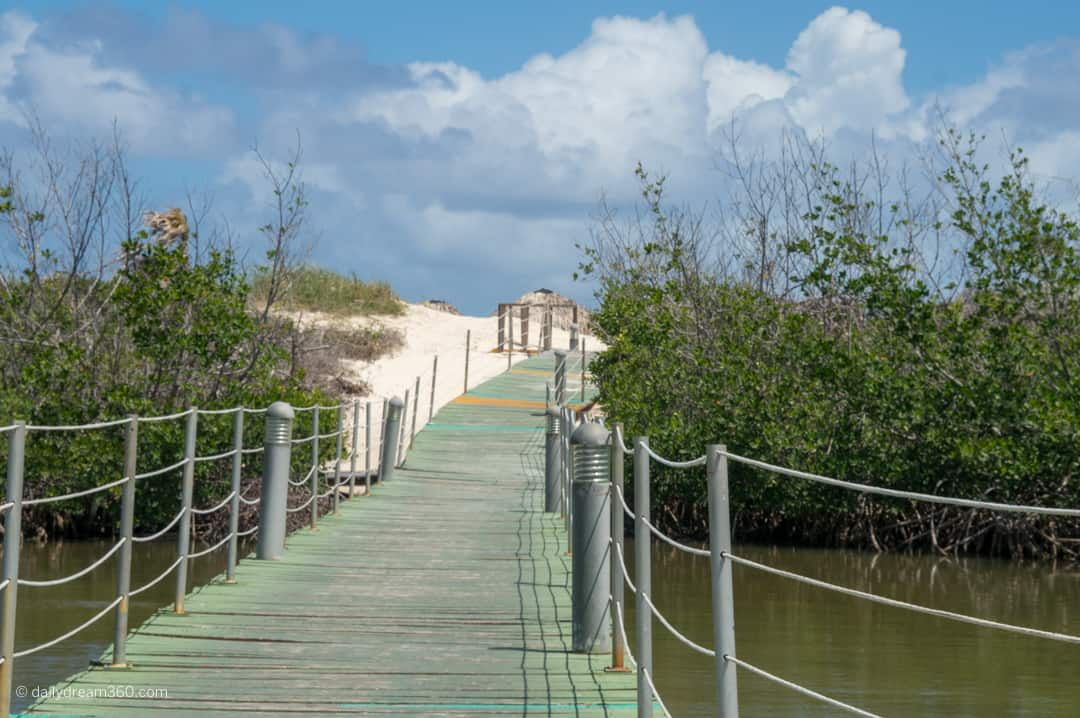 It is a long walk along the walkway through lagoons to beach area