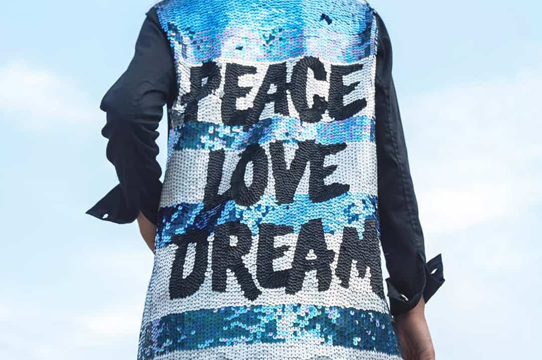 Blue, white striped Sequin black jacket with words Peace Love Dream