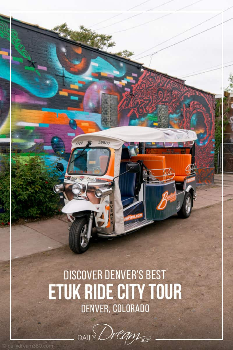 eTuk Ride vehicle parked in front of street mural Discover Denver's Best Neighbourhoods with an eTuk Ride