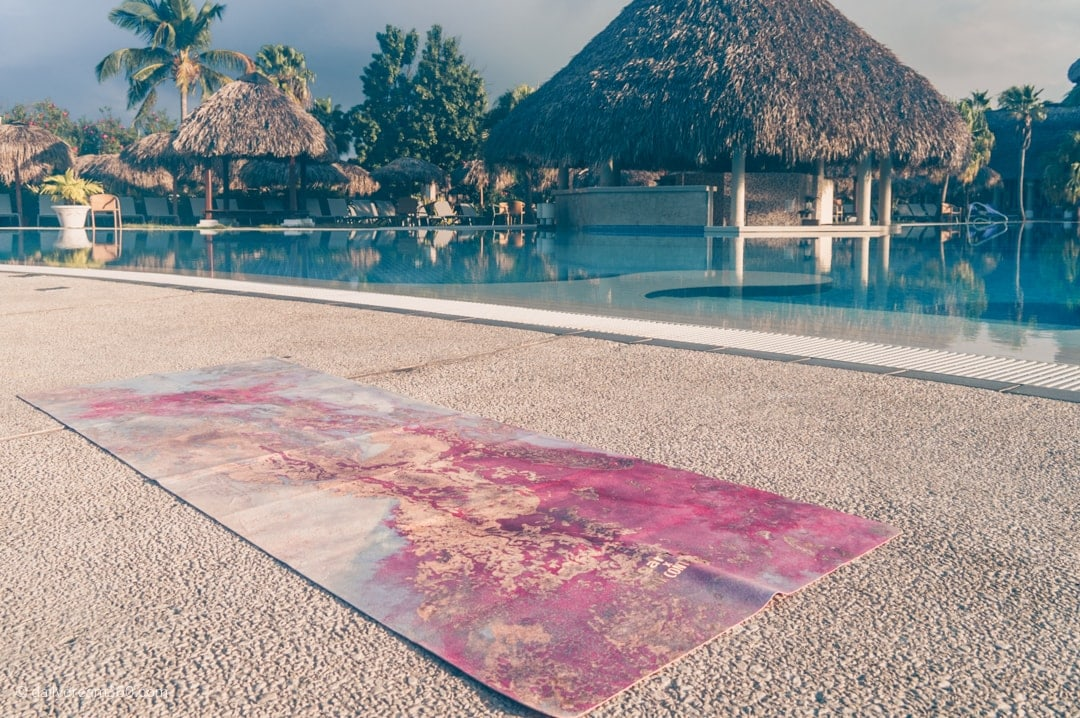 Sugarmat Travel Mat Dreamcatcher Red sitting beside pool in Cuba