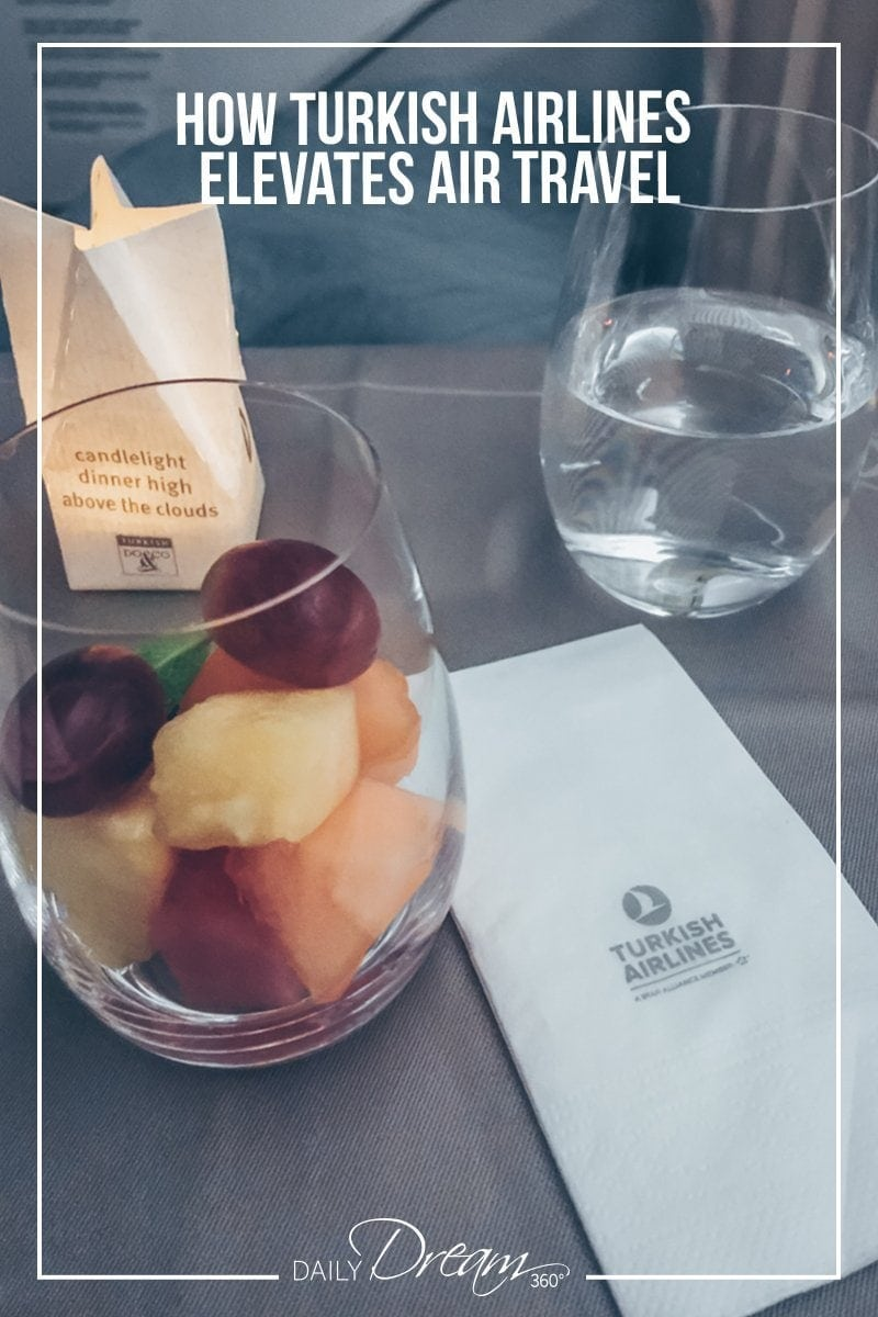 Fresh fruit in cup with candle light on tray in Business Class on Turkish Airlines