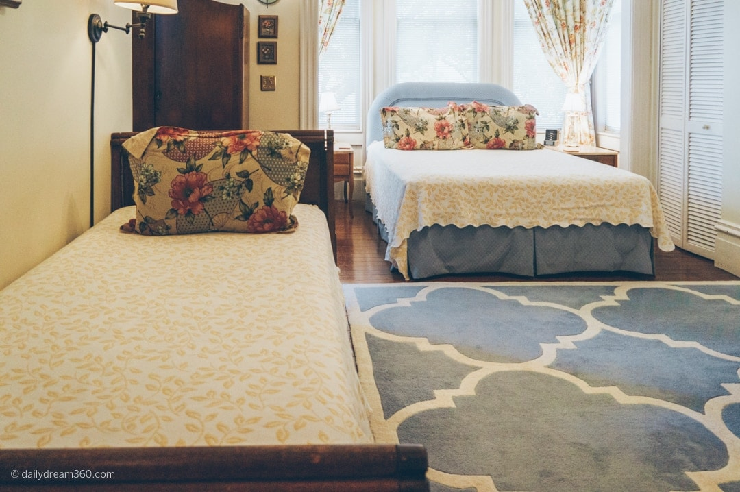 Two beds inside guest room at Fairbanks House BB