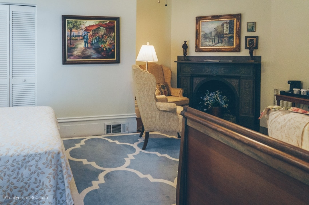 Room 2 had two beds and two chairs by a fireplace in Fairbanks House BB