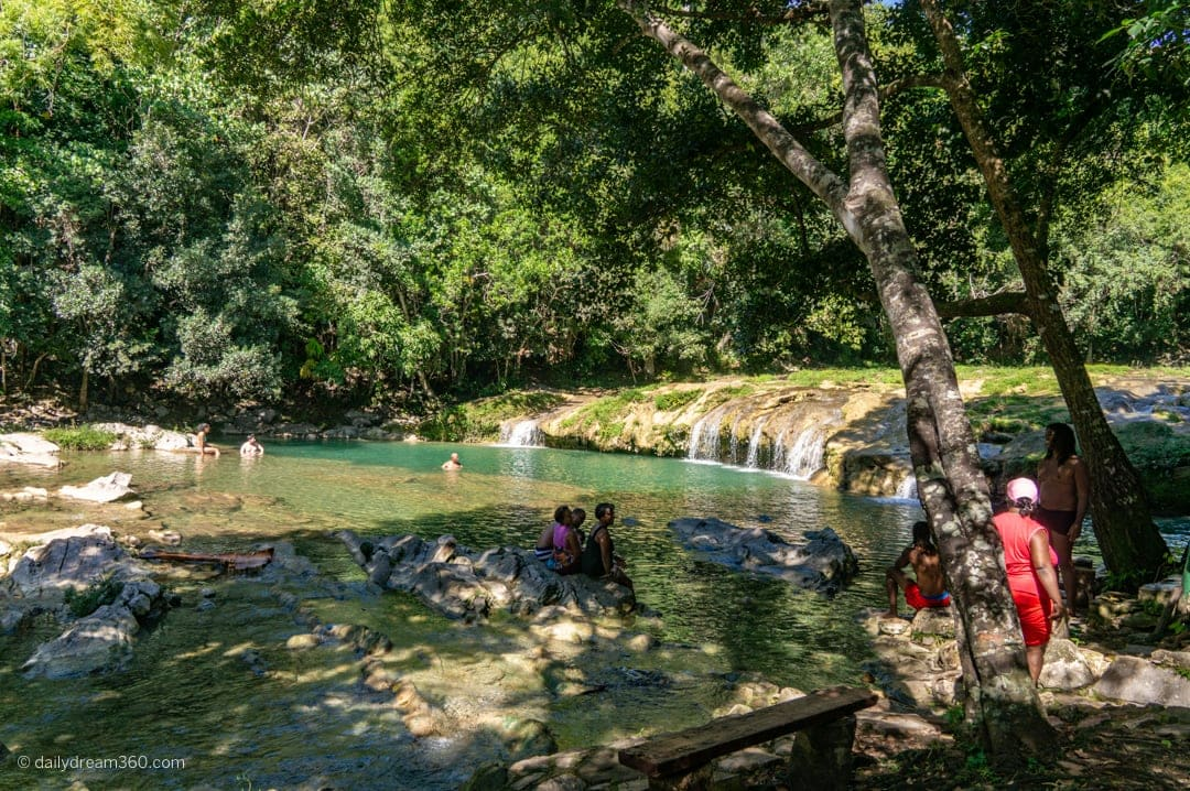 Cuban families swimming in river at Las Terrazas Eco Village