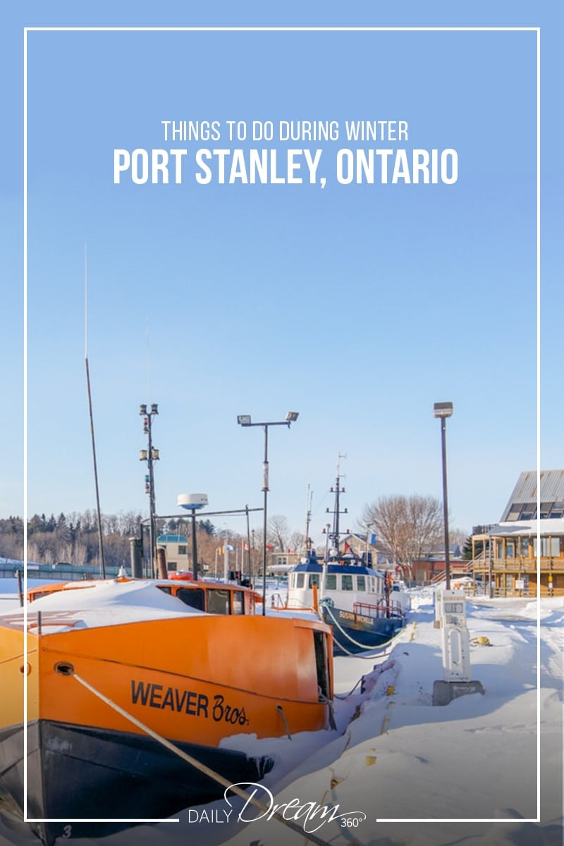 Walk the waterfront and see frozen boats along the shore.