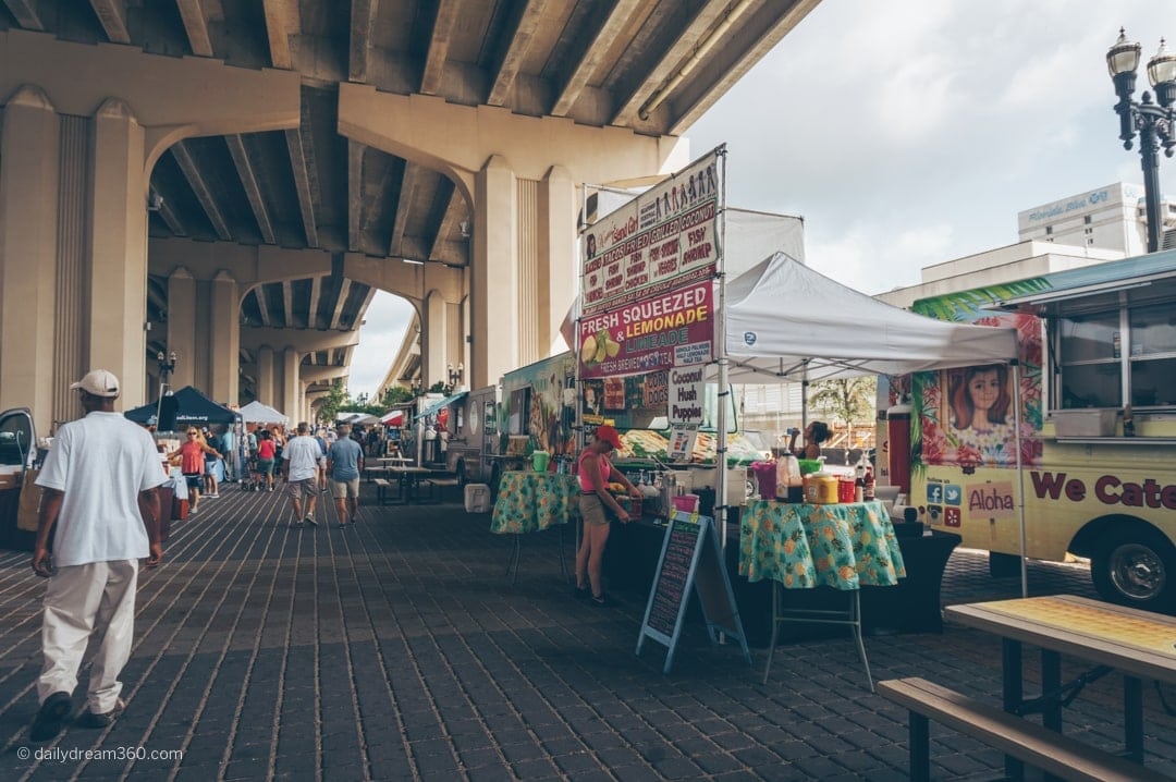 Riverside Arts market vendors set up under the overpass