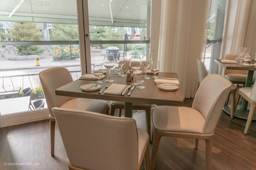 Bright, modern, beige furnishing in Sassafraz Toronto Restaurant