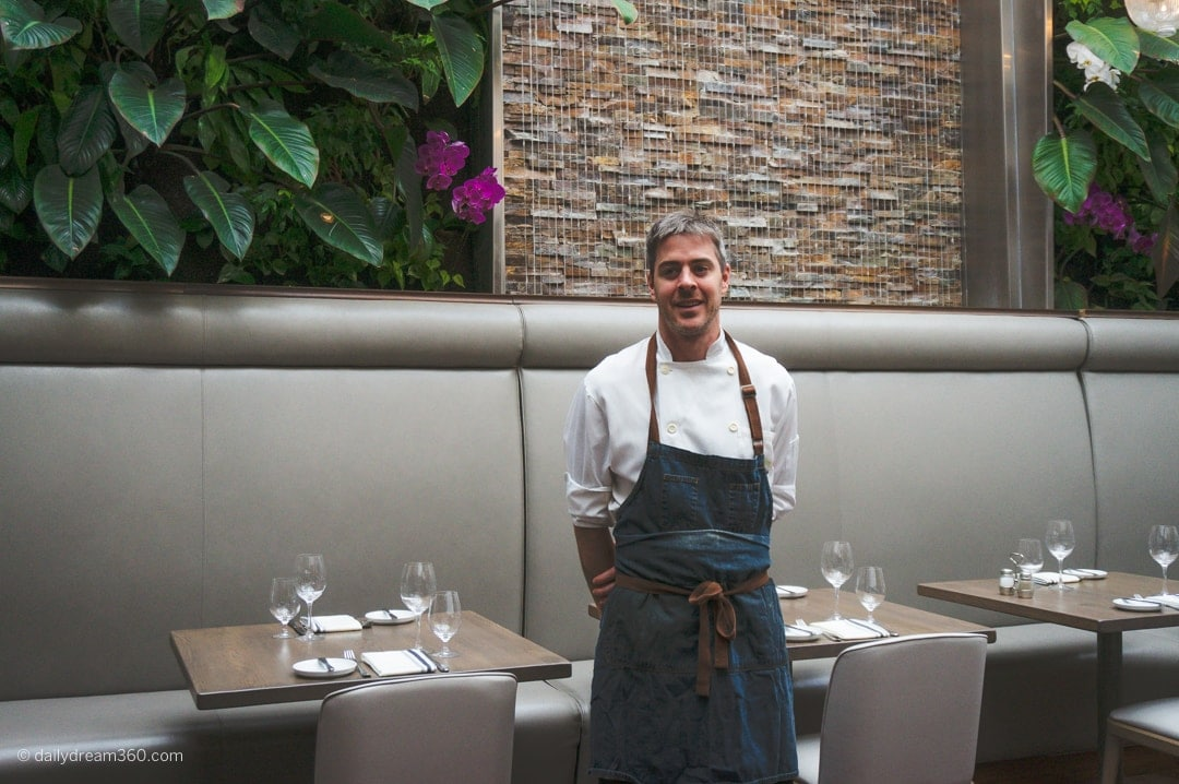 Sassafraz executive chef Geoff Webb stands inside restaurant.