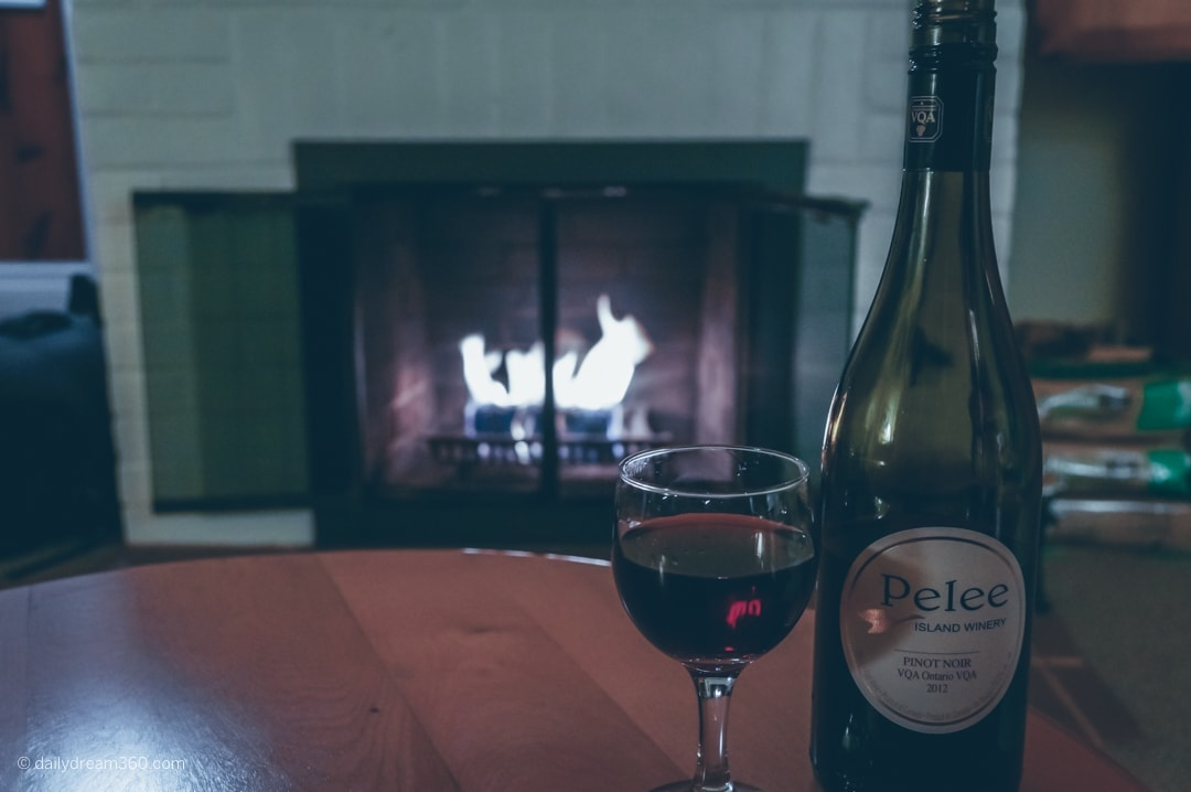 wine on table in front of fireplace at The Briars Resort and Spa