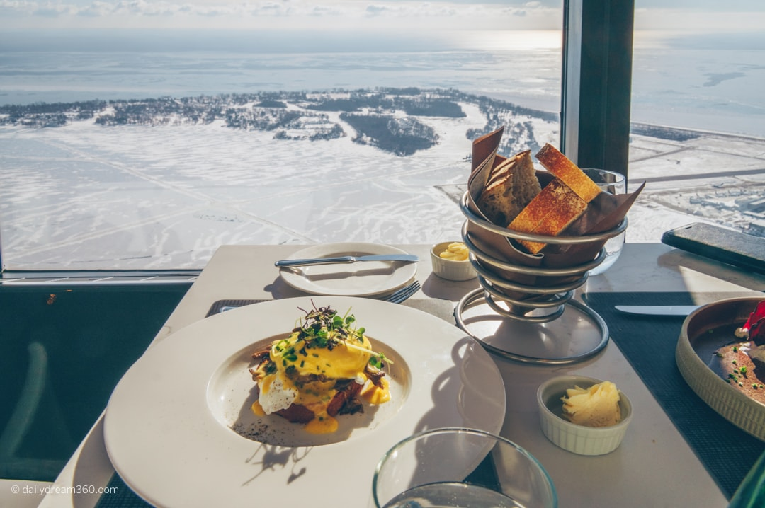 Meal on table overlooking lake Ontario from CN Tower 360 Restaurant Toronto