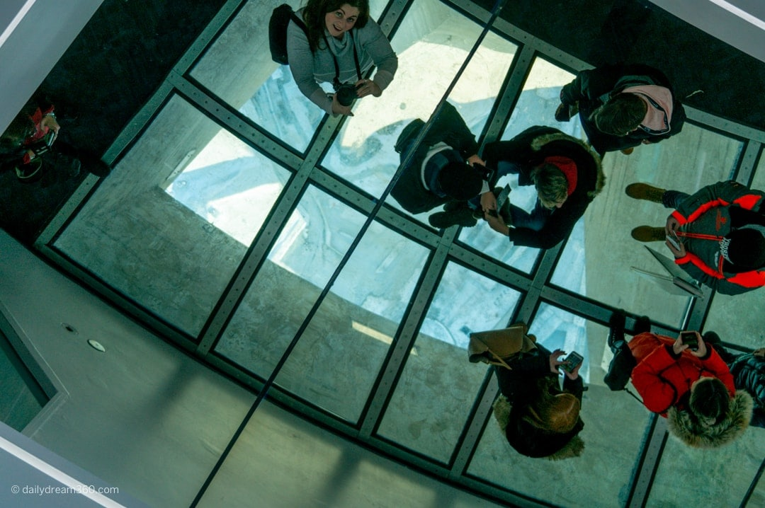 people on glass floor at CN Tower Toronto