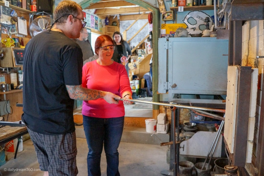 Sharon Mendelaoui gathers glass from furnace at Artech Glass in Haliburton