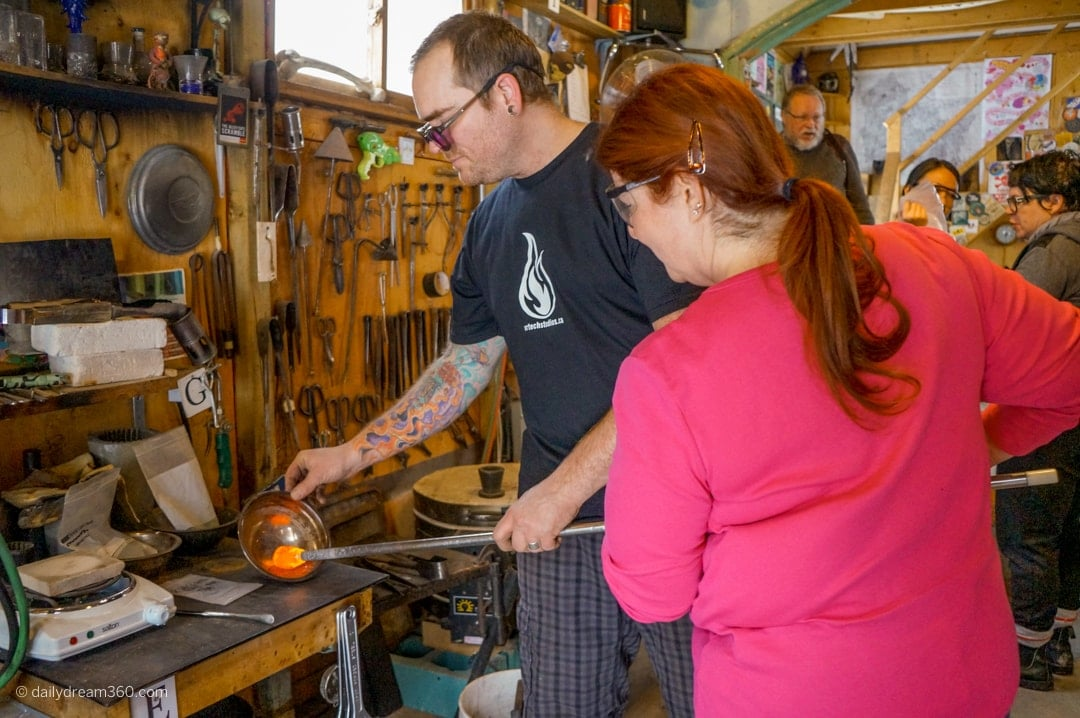 Terry Craig guides Sharon Mendelaoui in making glass art in workshop
